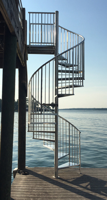 aluminum checkerplate spiral staircase on deck in alabama